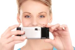 Happy woman using phone camera Royalty Free Stock Image