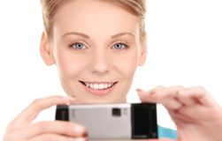 Happy woman using phone camera Stock Image