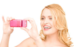 Happy woman using phone camera Stock Photo