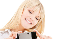 Happy woman using phone camera Royalty Free Stock Images