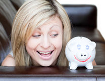 Happy woman using a piggybank Stock Photo