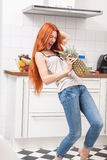 Happy Woman Using a Pineapple as Microphone Stock Photos