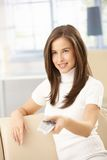 Happy woman using remote control Royalty Free Stock Photography