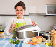 Happy  woman using slo-cooker Stock Photography