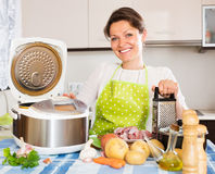 Happy  woman using slo-cooker Royalty Free Stock Photos