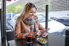 Happy woman using a smart phone. Stock Photography