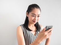 Happy woman using smartphone. stock images
