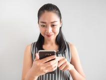 Happy woman using smartphone. royalty free stock photo