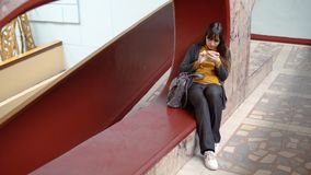 Happy woman using a smartphone indoors with marble walls. stock video