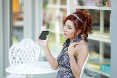 Happy woman using smartphone listen to music Royalty Free Stock Photography