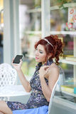 Happy woman using smartphone listen to music Royalty Free Stock Image