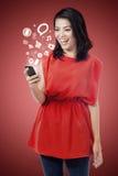 Happy woman using smartphone Stock Photography