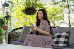 Happy woman using tablet in café royalty free stock photography
