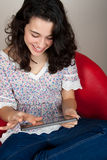 Happy woman using tablet pc Stock Photography