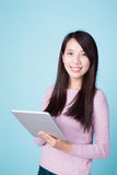 Happy woman using tablet pc. On blue background, asian beauty Royalty Free Stock Photos