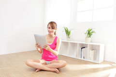 Happy woman using tablet pc. In the living room, asian beauty Royalty Free Stock Photos