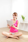 Happy woman using tablet pc. In the living room, asian beauty Stock Image