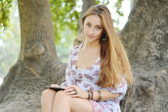 Happy woman using tablet pc in the park. Royalty Free Stock Images