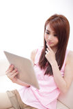 Happy woman using tablet pc on sofa. In the living room, asian beauty Royalty Free Stock Photo