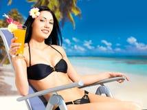 Happy woman on vacation enjoying at beach Stock Photo