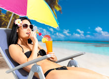 Happy woman on vacation enjoying at beach Stock Photo