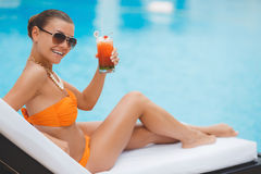 Happy woman on vacation near the blue pool Royalty Free Stock Photography