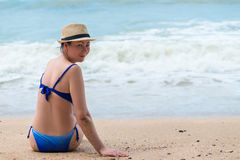 Happy woman on vacation on the sandy beach Stock Images