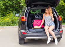 Happy woman on vacation. Summer holiday and car travel concept.  Royalty Free Stock Photography