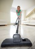 Happy woman with vacuum cleaner at home Royalty Free Stock Photography