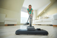 Happy woman with vacuum cleaner at home Royalty Free Stock Images