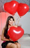 Happy woman on Valentine's Day with red balloons Royalty Free Stock Images
