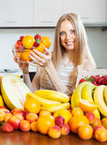 Happy  woman with   various fruits Stock Image