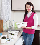 Happy woman with various sprouts Stock Photo