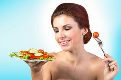 Happy Woman with vegetables salad. stock photo