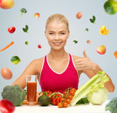 Happy woman with vegetarian food showing thumbs up Stock Image