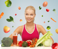 Happy woman with vegetarian food and vitamins Stock Images