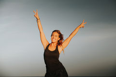 Happy woman. Victory sign. Success concept. Stock Photography