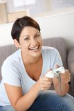 Happy woman with video game controller Stock Photo