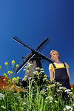 Happy woman in village with windmill Stock Photography