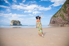 Happy woman vintage dress dancing at beach Royalty Free Stock Photography