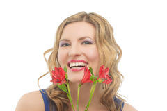 Happy woman with vivid fresh flowers Stock Images