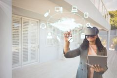 Happy woman in VR headset interacting with interface Stock Photography