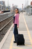 Happy woman waiting for a train Royalty Free Stock Photography