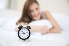 Happy woman waking up in the morning Royalty Free Stock Photo