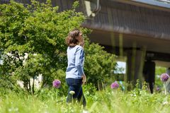 Happy woman walking in city park with mobile phone Royalty Free Stock Image