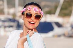 Happy woman walking and enjoying sunny day at marina Royalty Free Stock Photography
