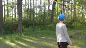 Happy woman walking in the forest in blue turban. Holidays concept stock video footage