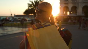 Happy woman walking after good shopping stock footage