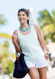 Happy woman walking in Miami Stock Photography