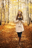Happy woman walking through park Stock Image